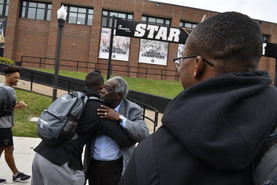 Vanderbilt Athletic Director David Williams, center, hugs a student after announcing his resignation.