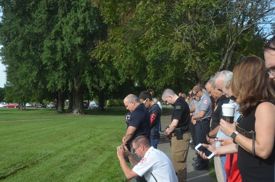Attendees at Hendersonville's 9/11 commemorative ceremony bowed their heads in prayer.
