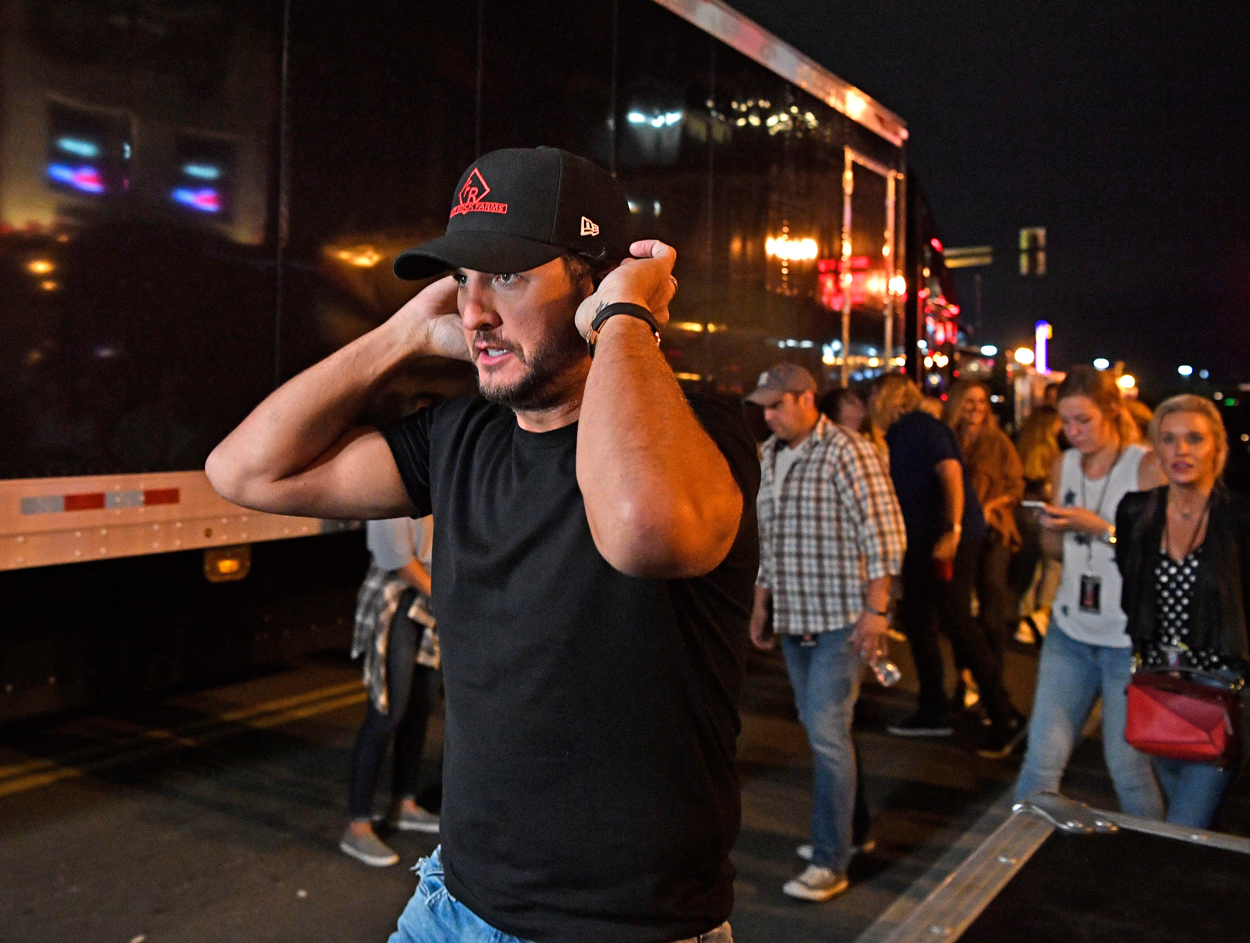Luke Bryan prepares to go on stage and perform a concert for fans in front of his new bar Luke's 32 Bridge at 3rd and Broadway Monday Sept. 10, 2018, in Nashville, Tenn.