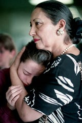 Student counselor Dr. Arshi Nasseh from Hillsboro High School embraces 12-year-old Mary Nolan, a seventh-grader at John Trotwood Moore Middle School, on April 22, 1994, the day after the fatal shooting of Terrance Murray.