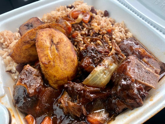 Braised oxtails with plantains and rice and peas from Island Vybz Caribbean Cuisine inside Coastland Center mall in Naples.