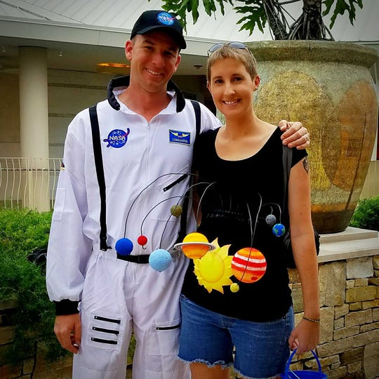 Lauren Osborne, of Naples, 7 months pregnant at the time, made a solar system outfit and a NASA astronaut suit for her husband last year at Halloween.