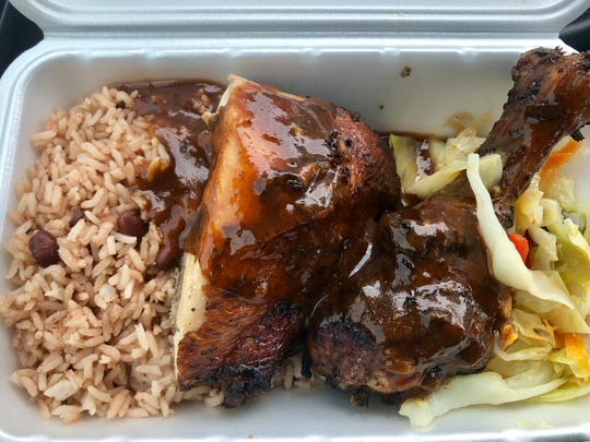 Jerk chicken with steamed cabbage and rice and peas from Island Vybz Caribbean Cuisine inside Coastland Center mall in Naples.