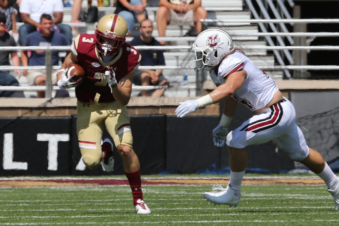 Boston College senior wide receiver Michael Walker took on former teammate Chris Riley and Joe Lang of Community School in the Golden Eagles' home win against Holy Cross last Saturday.