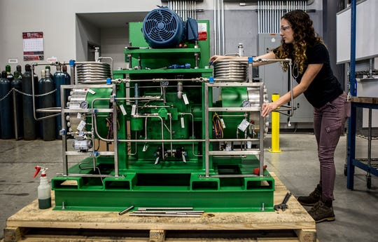 Alivia Didion works on building a co2 compressor at Apeks Supercritical in Johnstown, Ohio.