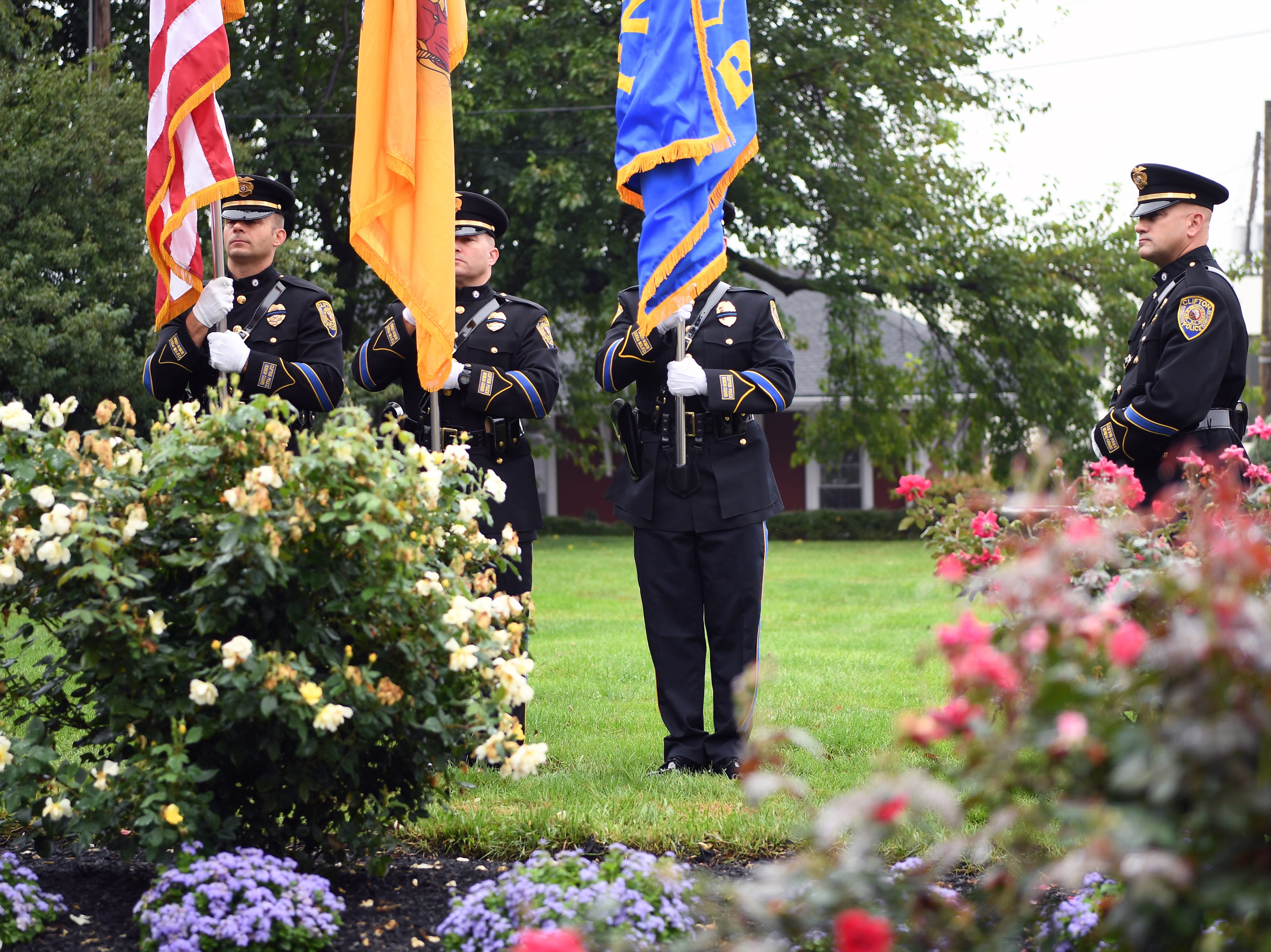 Members of Clifton PD during a 9/11 memorial service at Clifton City Hall on Tuesday, September 11, 2018.