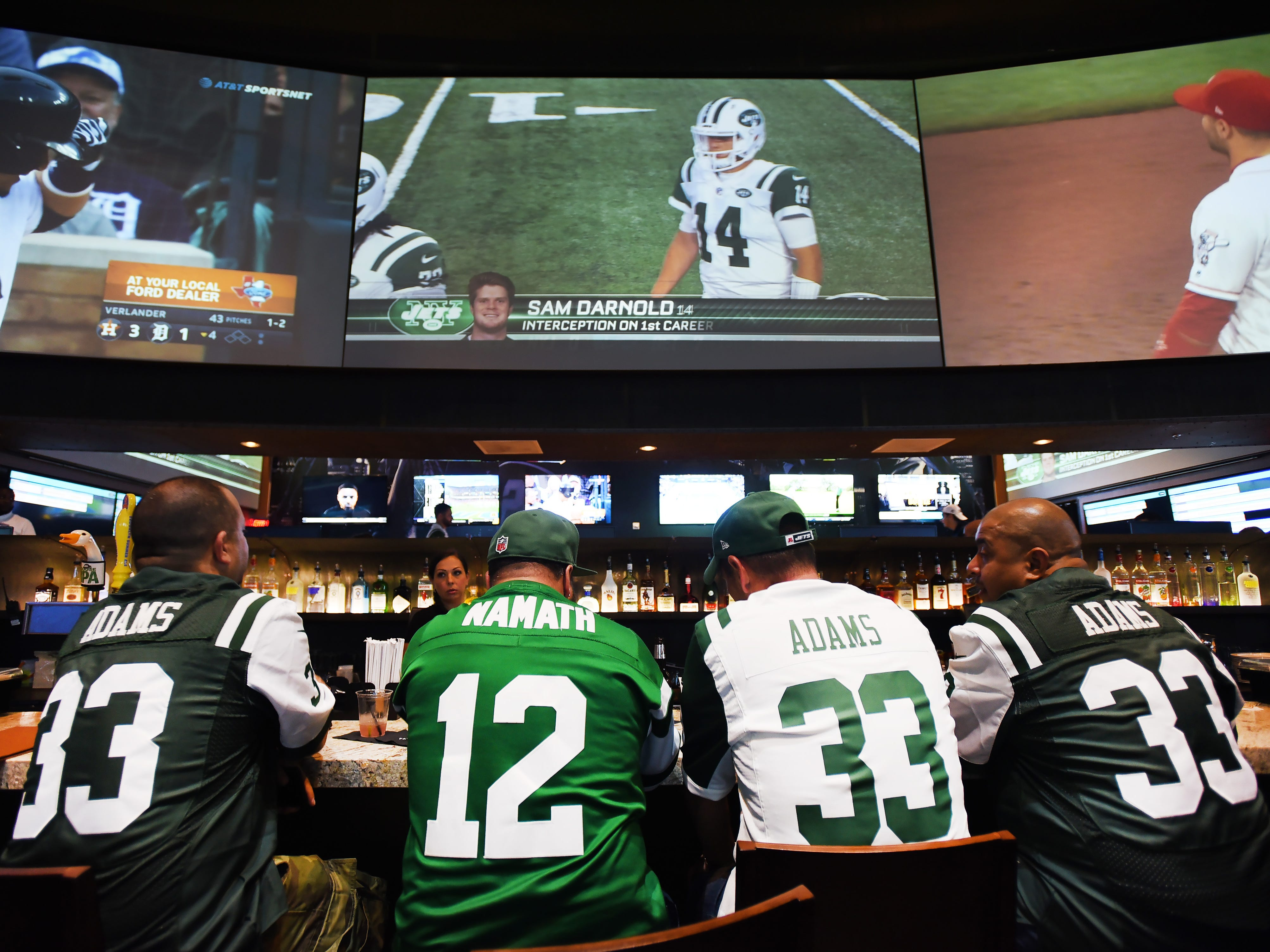 Fans watch the game on large screens during a Jets game viewing party for fans at the FanDuel Sportsbook, located at Meadowlands Racing & Entertainment area in East Rutherford on 09/10/18.