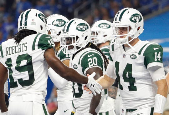 Sep 10, 2018; Detroit, MI, USA; New York Jets quarterback Sam Darnold (14) shakes hands with wide receiver Andre Roberts (19) during the first quarter against the Detroit Lions at Ford Field. Mandatory Credit: Raj Mehta-USA TODAY Sports