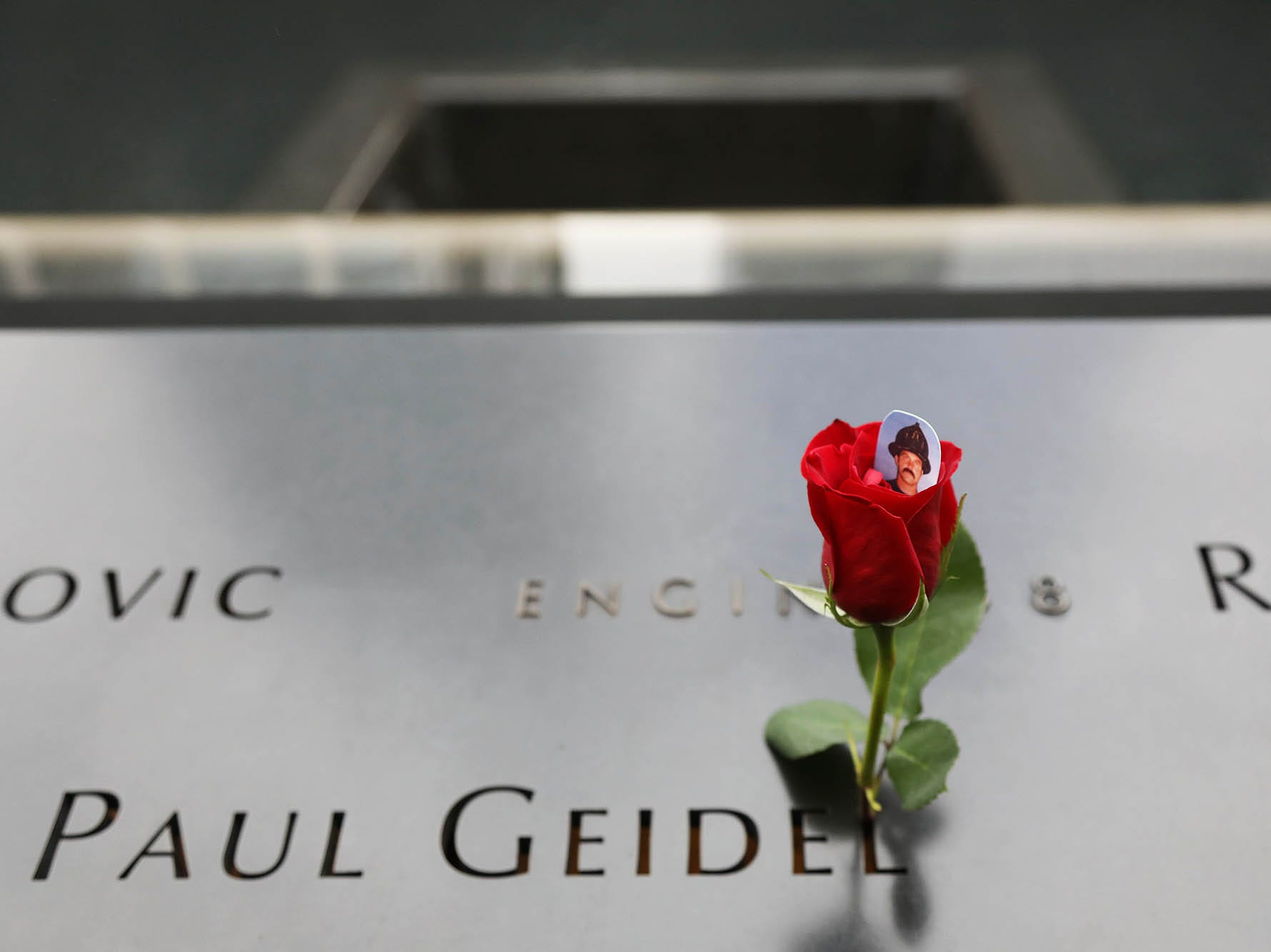 A flower placed on the South Tower Memorial is placed by the name of Paul Geidel with Engine Co. 8 during ceremonies at the National September 11 Memorial observing the 17th anniversaryof the attacks that killed people in Manhattan, the Pentagon, Flight 93 and honoring those who died in the 1993 World Trade Center bombing.