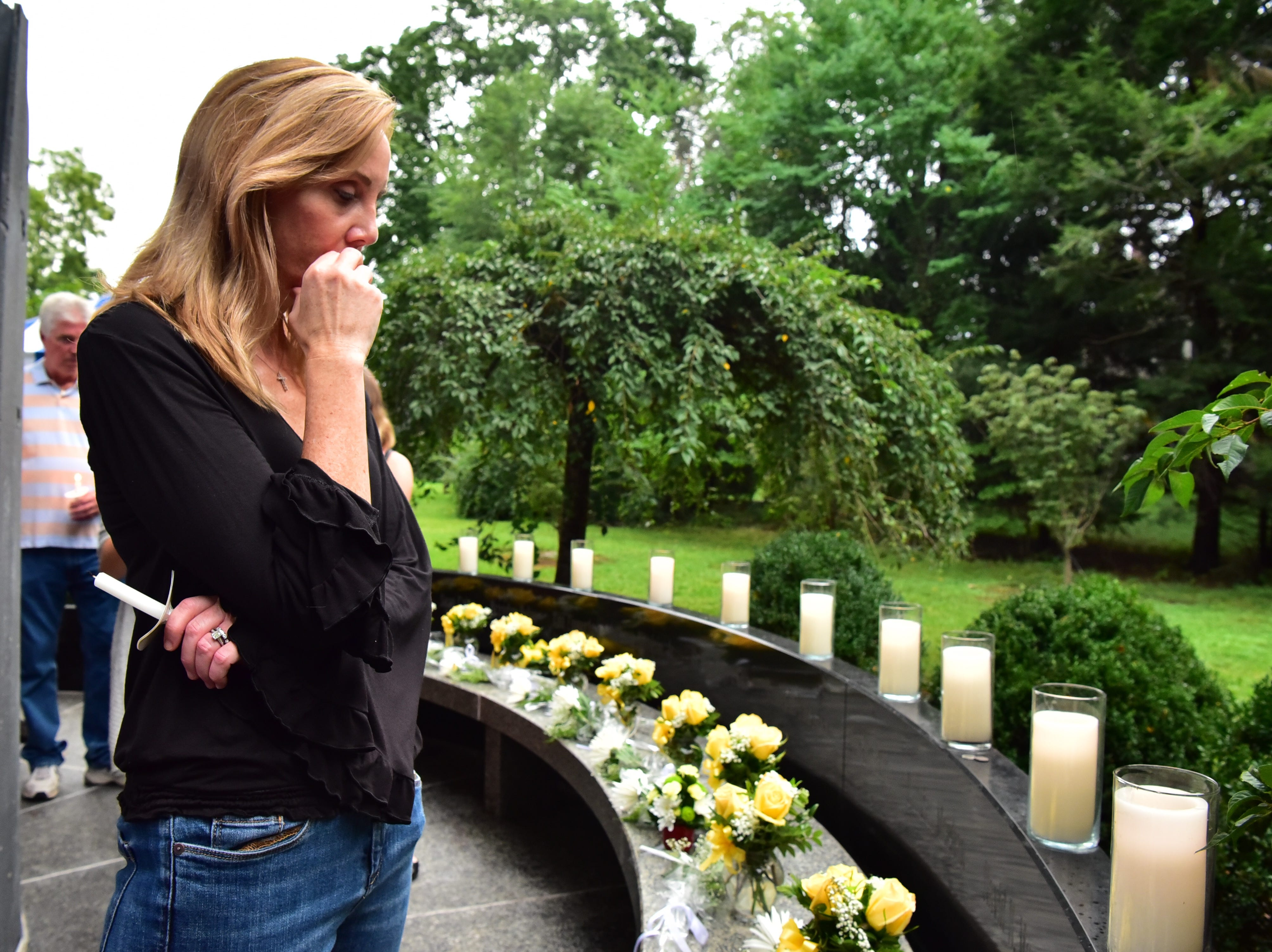 Colleen Golden pays respects to her father Dick Morgan, a 9-11 victim at the memorial in Glen Rock, NJ.