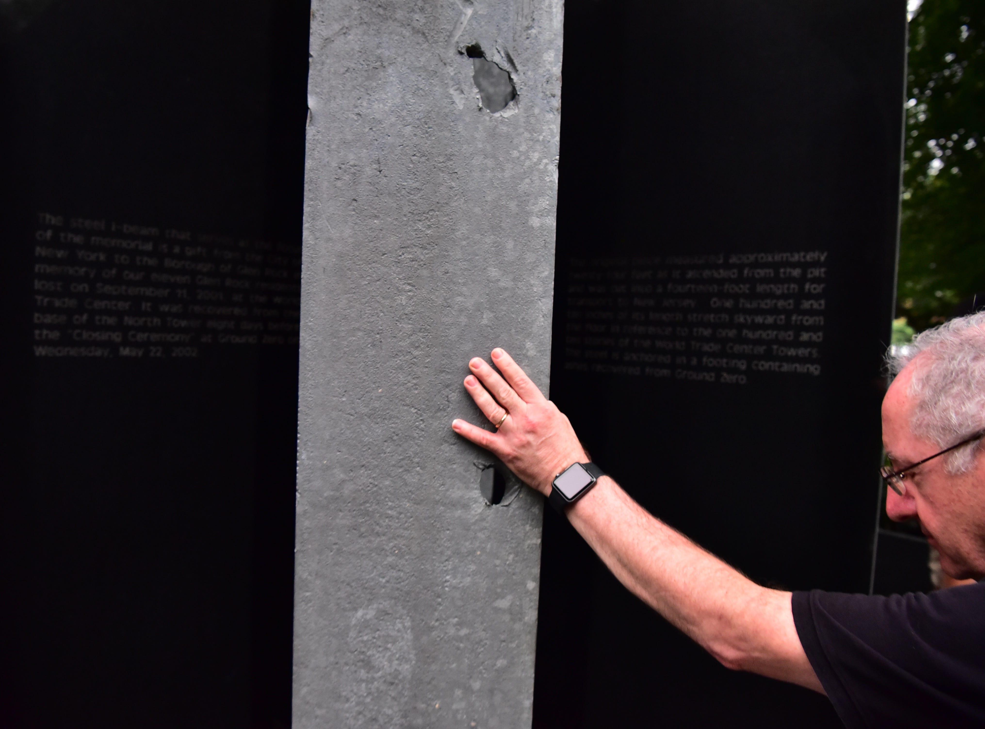 George Carbone pauses at the steel beams at 9-11 memorial in Glen Rock, NJ.