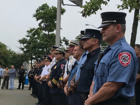Passaic police and firefighters at the 9/11 remembrance on Tuesday.
