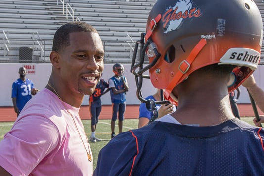 Photo 1 Victor Cruz Talks With A Player At A Paterson Football Practice Last Week