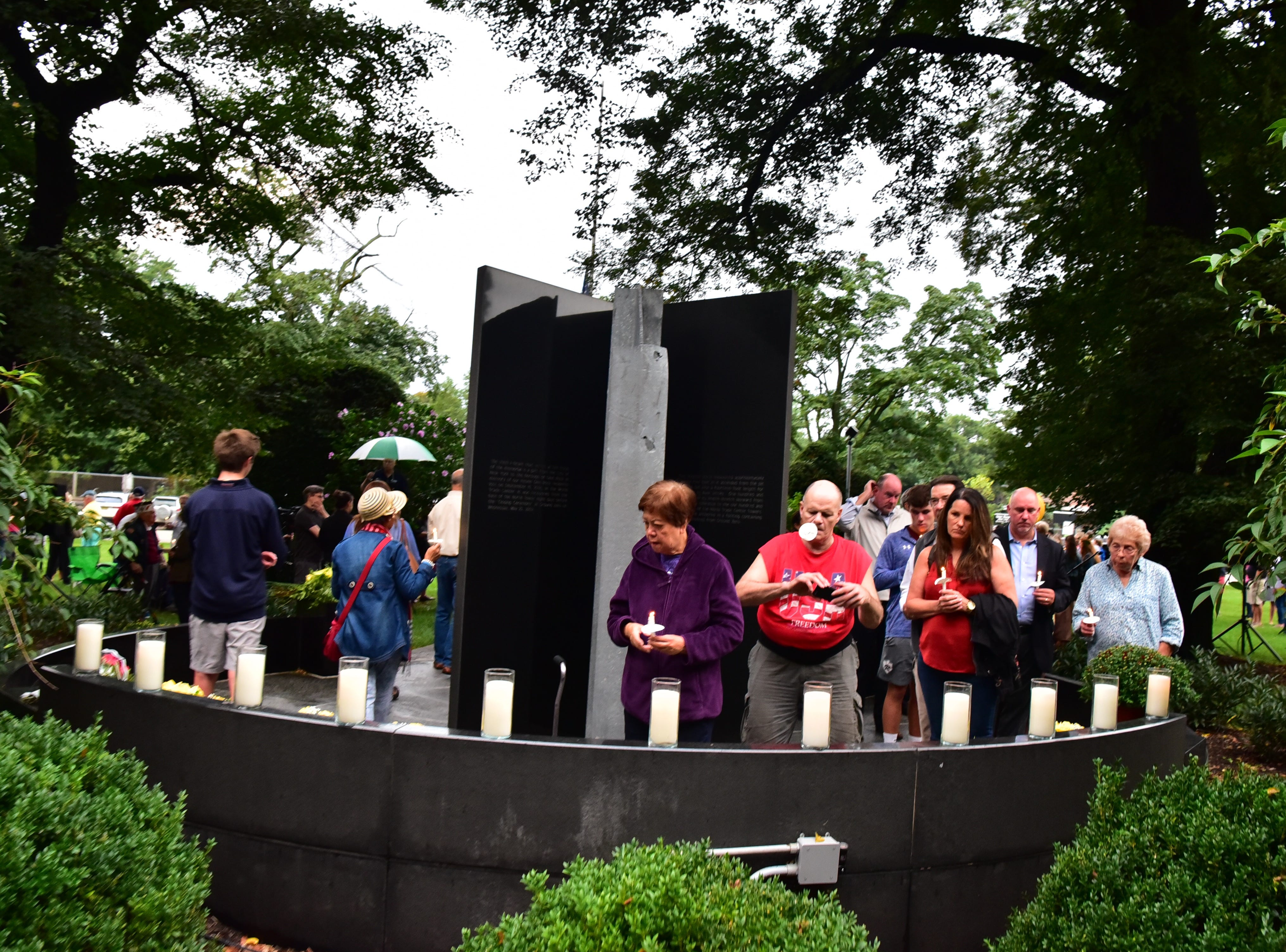 Visitors pay respect to the 9-11 victims at the memorial in Glen Rock, NJ.