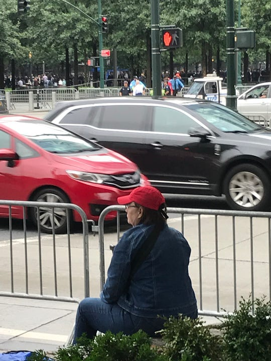 Mary McGee, 69, a retired secretary, came from Cleveland for 9/11 anniversary.  Because she is not related to any of the victims and is not a first responder, she was barred from the ceremonies at the National 9/11 Memorial plaza.  Here, she sits on a ledge, at Liberty and West Streets, across from the plaza.