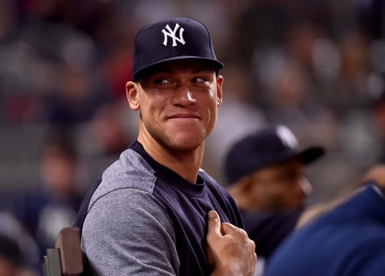 Aug 21, 2018; Miami, FL, USA; New York Yankees right fielder Aaron Judge (99) reacts to a fan in the eleventh inning against the Miami Marlins at Marlins Park.