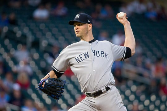 New York Yankees starting pitcher J.A. Happ (34) pitches in the first inning against Minnesota Twins at Target Field.