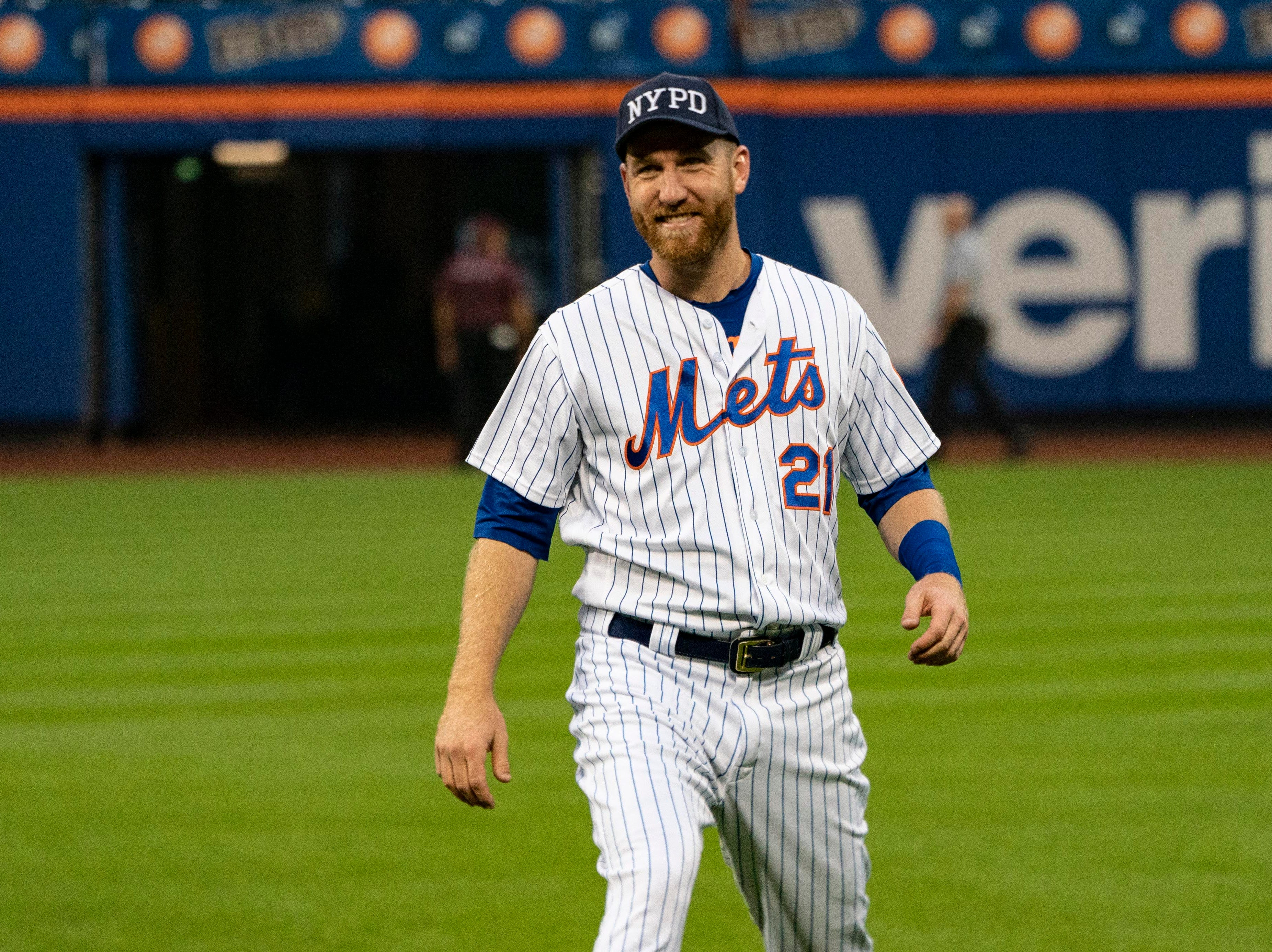 Sep 11, 2018; New York City, NY, USA; New York Mets third baseman Todd Frazier (21) wears a NYPD cap to show respect for first responders on September 11 before the game against the Miami Marlins at Citi Field. Mandatory Credit: Gregory J. Fisher-USA TODAY Sports