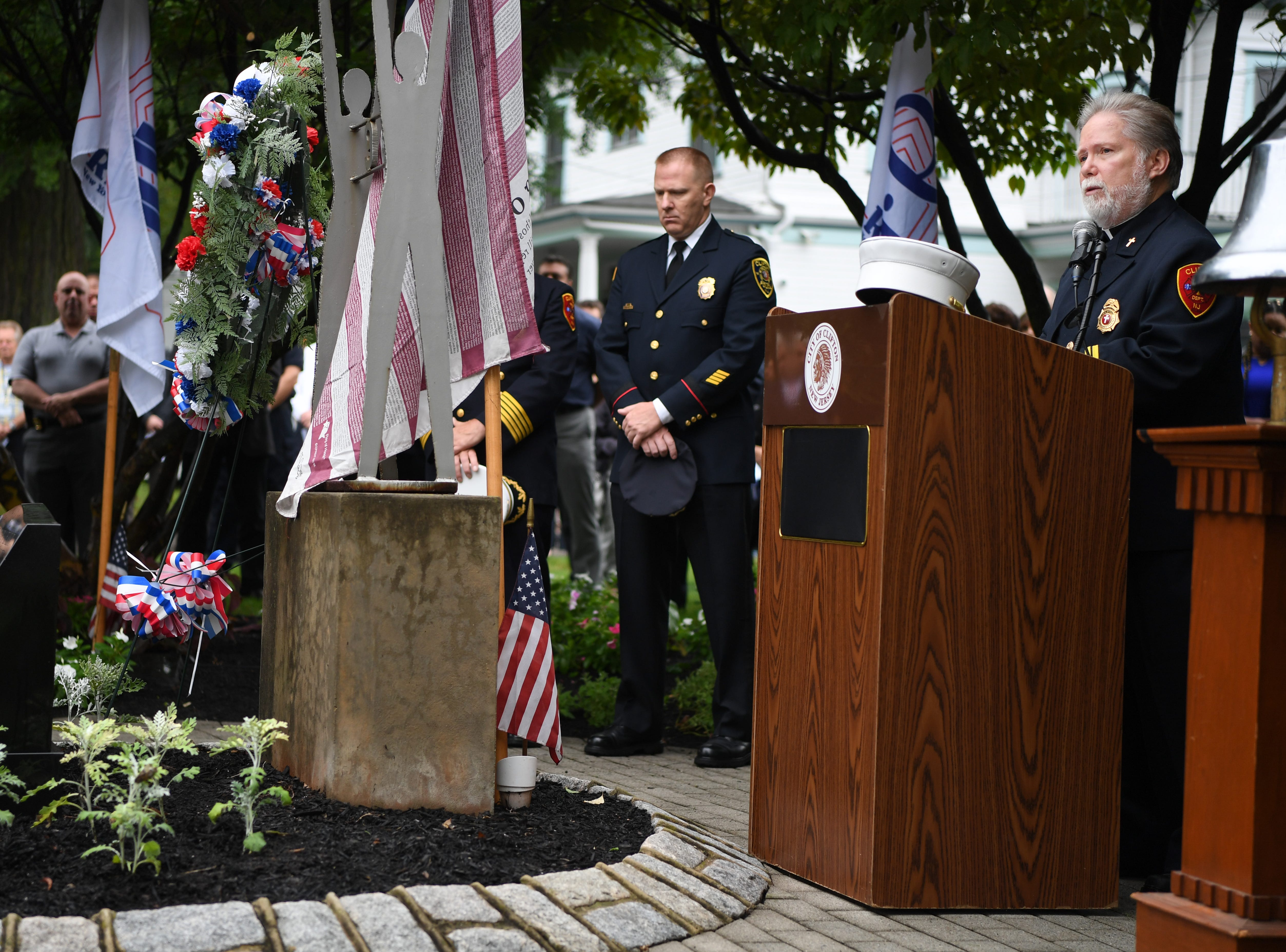9/11 memorial service at Clifton City Hall on Tuesday, September 11, 2018. Fr. Alan Savitt gives an invocation.