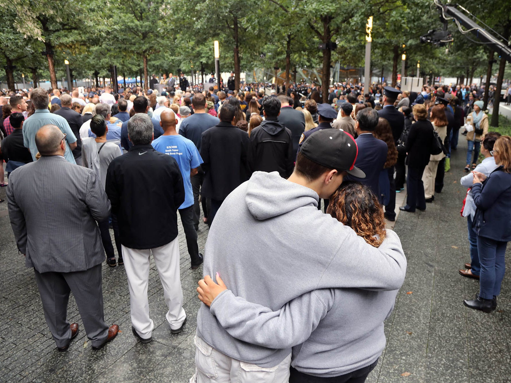 A couple hug as they listen to the names of those who perished on 911. This was during ceremonies at the National September 11 Memorial observing the 17th anniversary of the attacks that killed people in Manhattan, the Pentagon, Flight 93 and honoring those who died in the 1993 World Trade Center bombing.