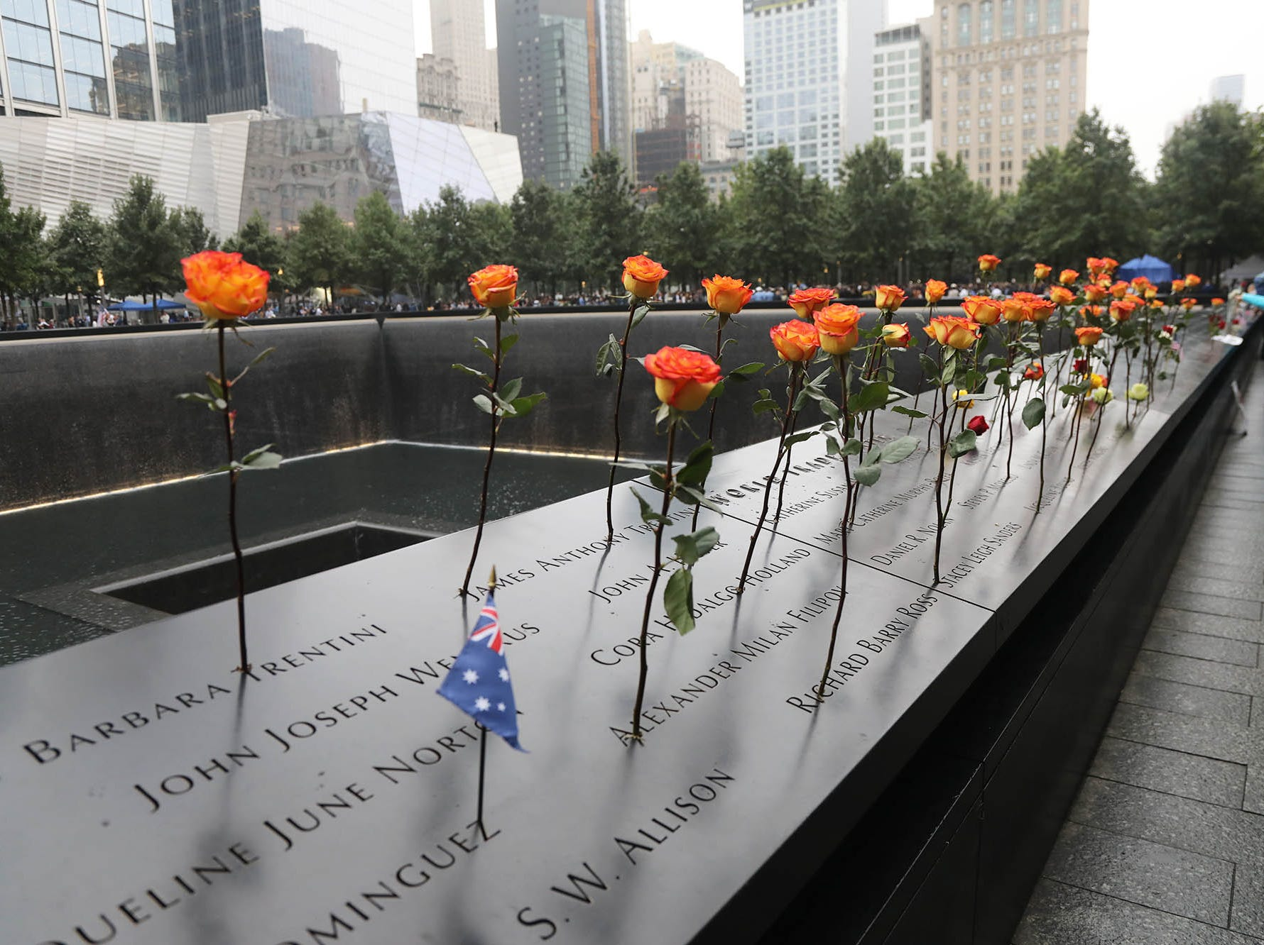 Flowers are placed on the names at the North Tower memorial during ceremonies at the National September 11 Memorial observing the 17th anniversary of the attacks that killed people in Manhattan, the Pentagon, Flight 93 and honoring those who died in the 1993 World Trade Center bombing.
