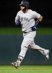 New York Yankees' Gary Sanchez runs the bases on a solo home run off Minnesota Twins pitcher Kyle Gibson in the sixth inning of a baseball game Monday, Sept. 10, 2018, in Minneapolis.