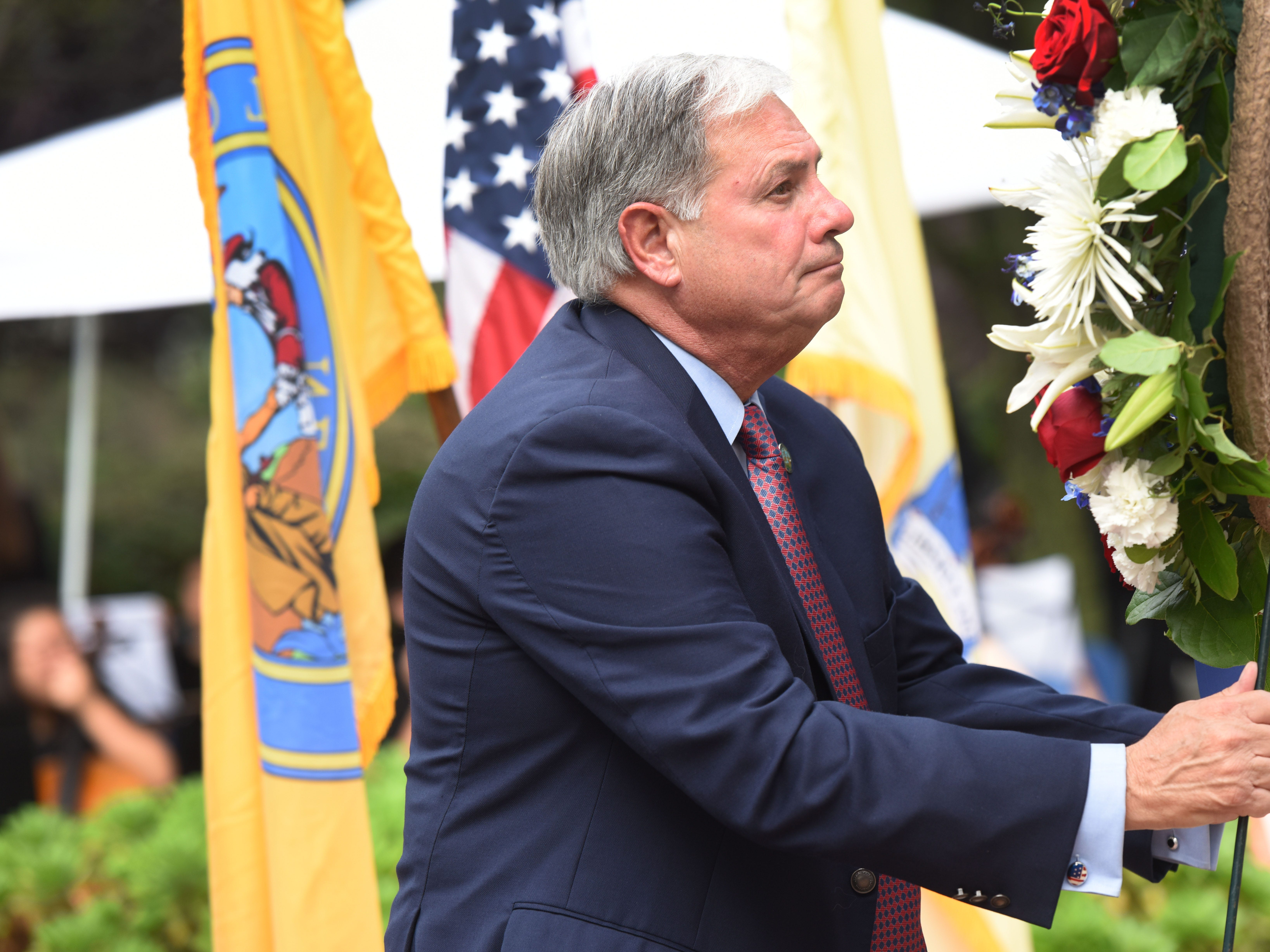 County Executive Jim Tedesco lays a wreath during the Bergen County 9/11 memorial ceremony in Overpeck Park.