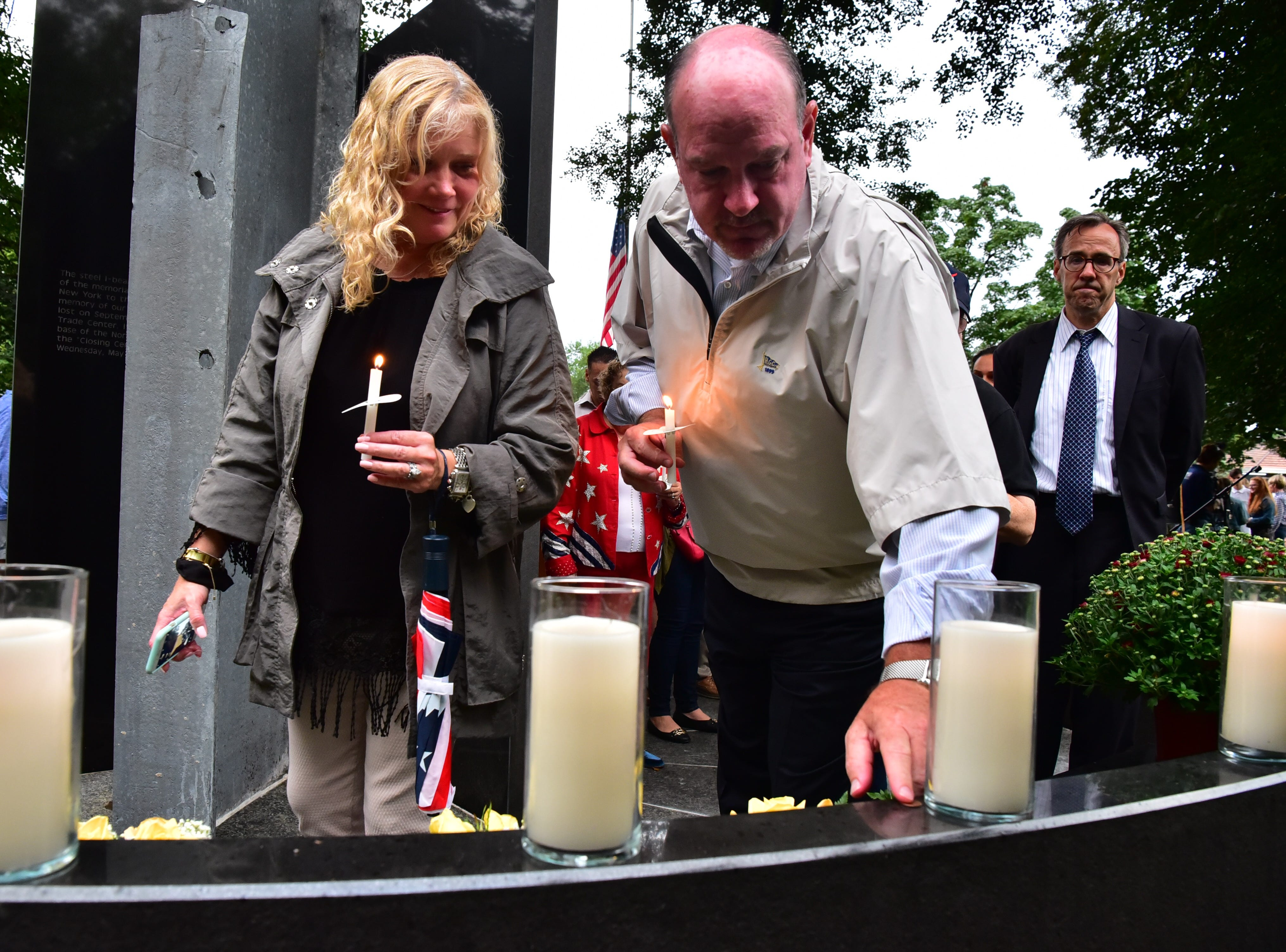 John Henderson and his wife Alison, pay respect to her brother and 9-11 victim Sean Calon at 9-11 memorial in Glen Rock, NJ.