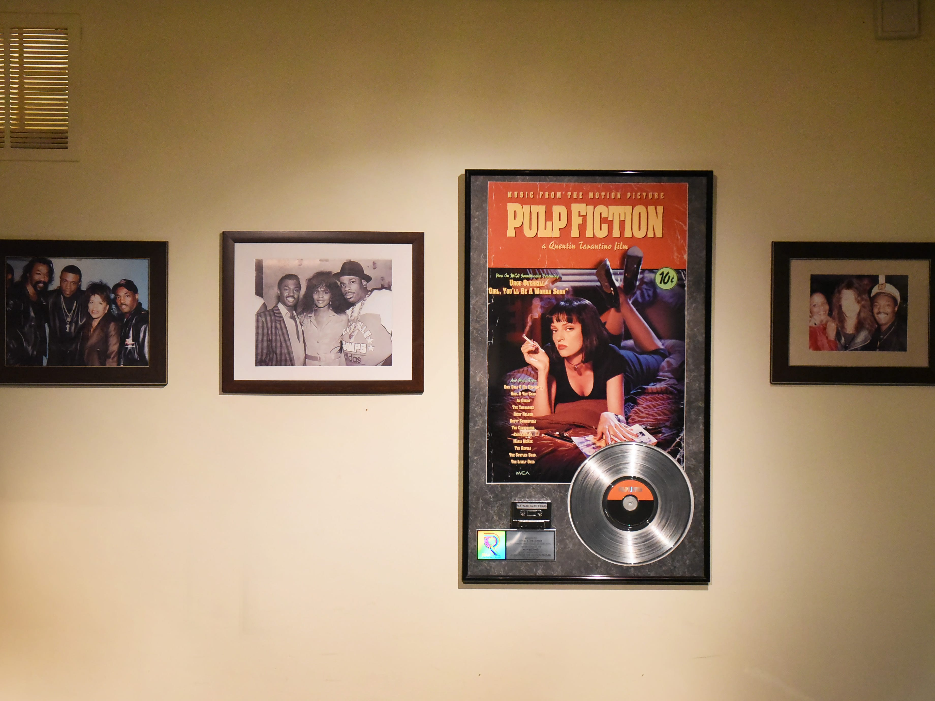 Photos and a plaque belonging to his family are seen on the wall at his office in Montclair on 09/10/18.  His new track ROYALTY will make its debut on WBLS next Thursday.