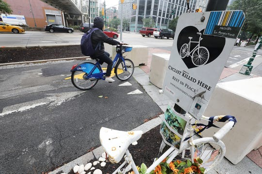A memorial sign marks a bike path on West St. crossing  Chambers St. where eight bicyclists were killed on October 31, 2017 adding to the victims of terrorist attacks that have taken place in lower Manhattan. There were ceremonies today at the National September 11 Memorial observing the 17th anniversary of the attacks that killed people in Manhattan, the Pentagon, Flight 93 and honoring those who died in the 1993 World Trade Center bombing.