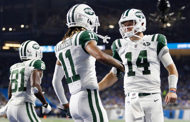 Sep 10, 2018; Detroit, MI, USA; New York Jets wide receiver Robby Anderson (11) celebrates with quarterback Sam Darnold (14) after the two connect for a touchdown during the second quarter against the Detroit Lions at Ford Field. Mandatory Credit: Raj Mehta-USA TODAY Sports