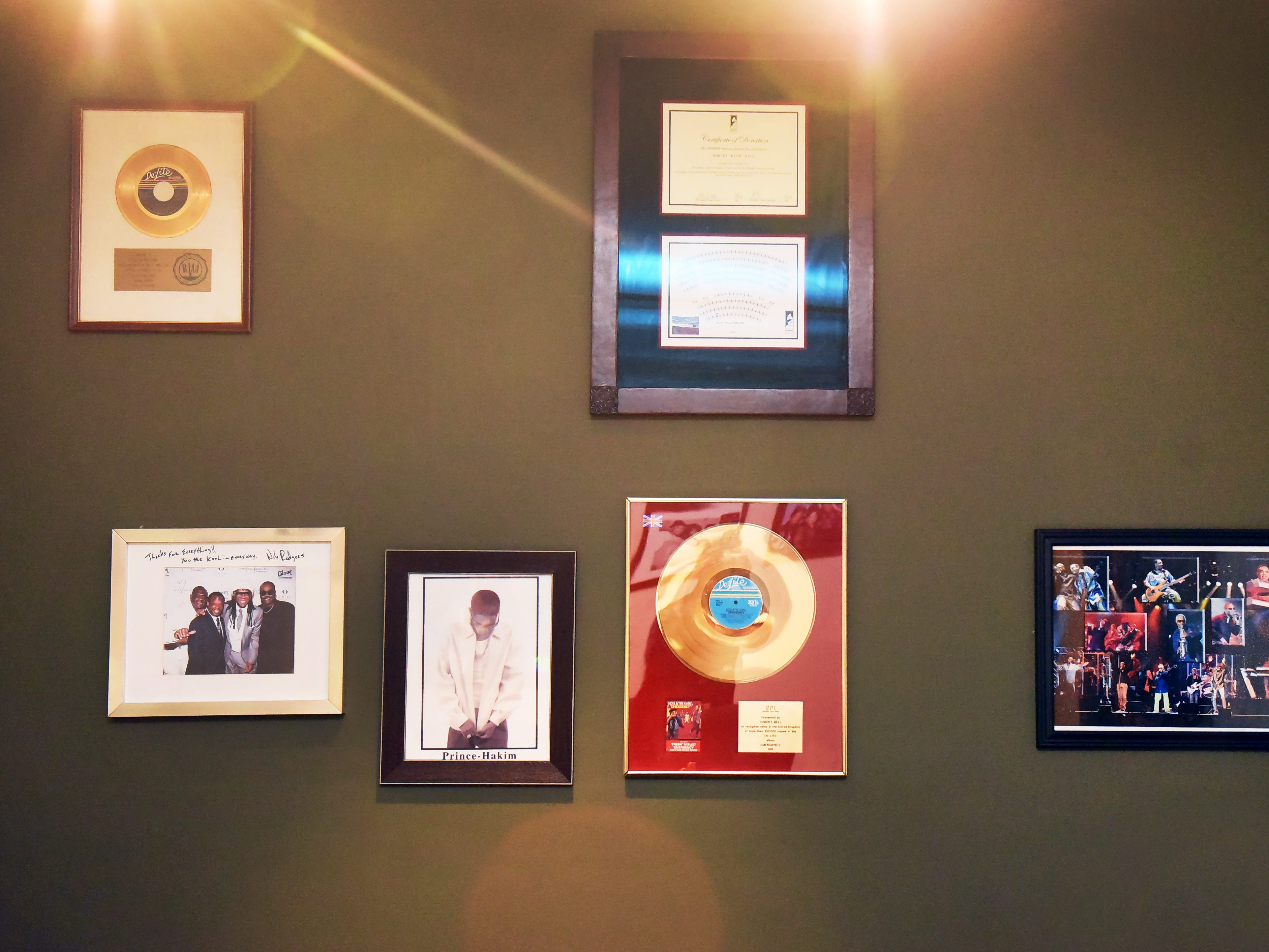 Photos and plaques belonging to his family are seen on the wall at his office in Montclair on 09/10/18.  His new track ROYALTY will make its debut on WBLS next Thursday.