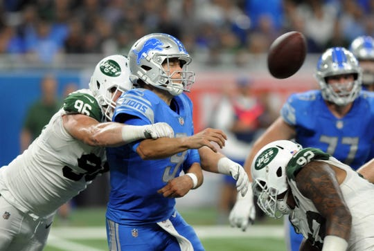 New York Jets defensive end Henry Anderson (96) hits Detroit Lions quarterback Matthew Stafford's (9) arm as he throws during the second half of an NFL football game in Detroit, Monday, Sept. 10, 2018. (AP Photo/Jose Juarez)