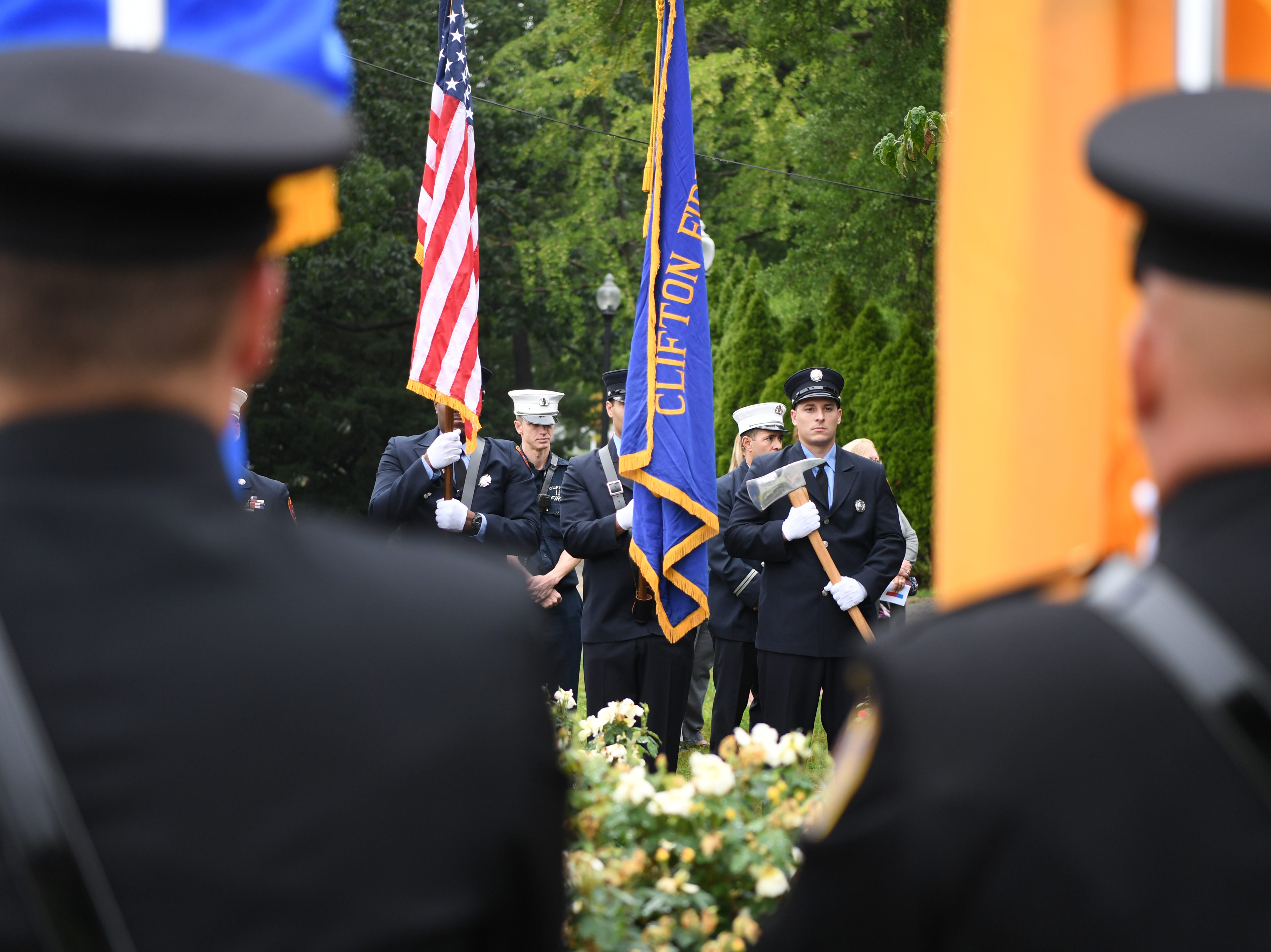 Members of Clifton FD during a 9/11 memorial service at Clifton City Hall on Tuesday, September 11, 2018.