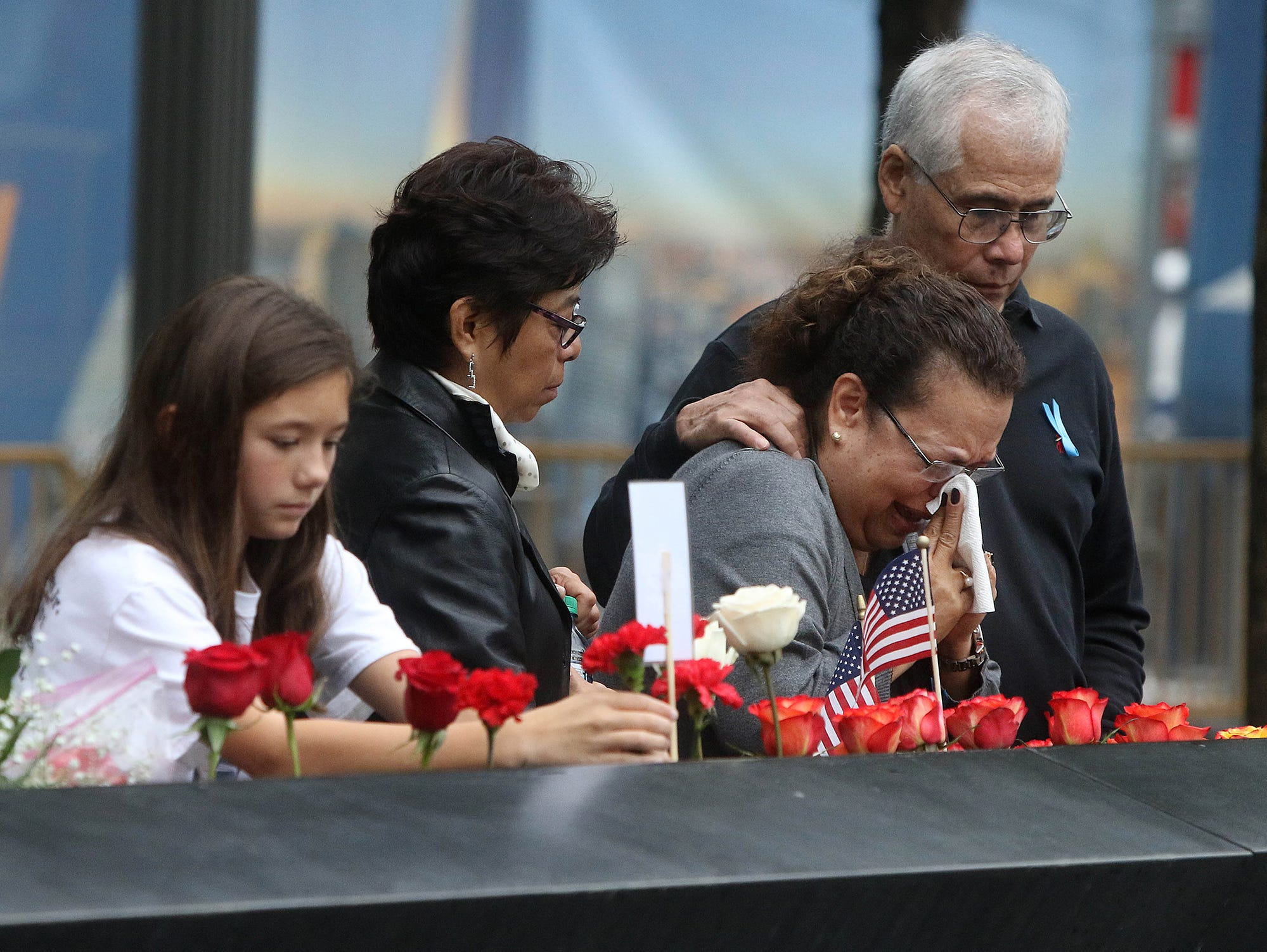 A woman is overcome with emotion at the North Tower Memorial during ceremonies at the National September 11 Memorial observing the 17th anniversaryof the attacks that killed people in Manhattan, the Pentagon, Flight 93 and honoring those who died in the 1993 World Trade Center bombing.