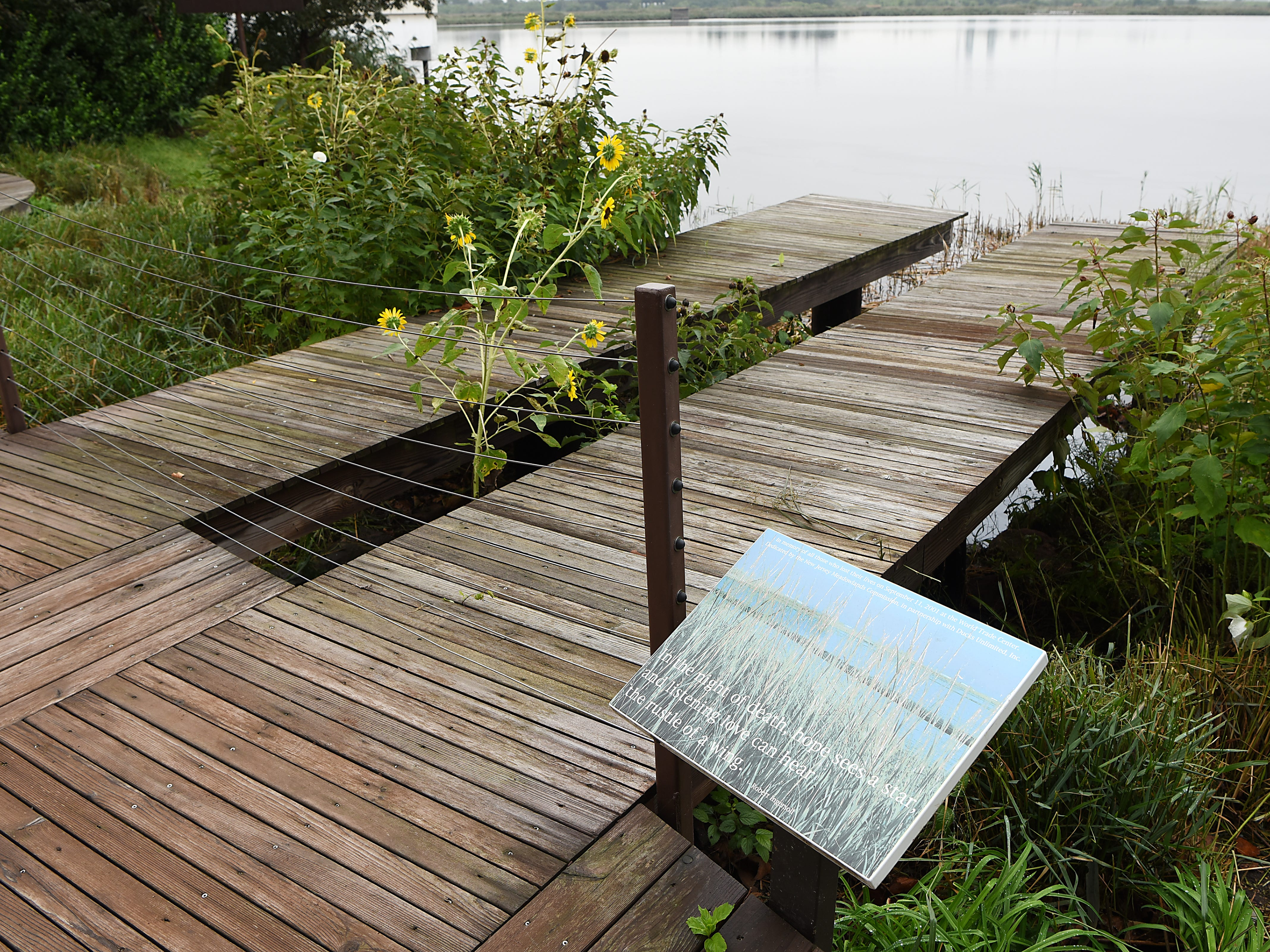 September 11th memorial at DeKorte Park in Lyndhurst on Tuesday September 11, 2018. The memorial consists of two identical piers jutting over a marsh and depicting the shadows of the Twin Towers. Each wooden pier has 110 slats, representing the towers' 110 floors. A porcelain enamel plaque is inscribed with a dedication to the 9/11 victims.