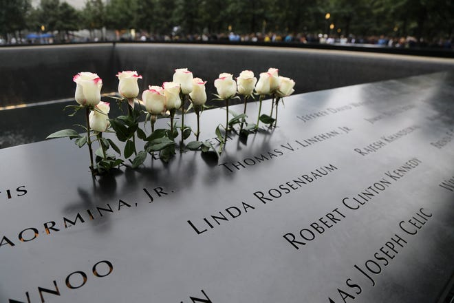 Flowers on the North Tower during ceremonies at the National September 11 Memorial observing the 17th anniversary of the attacks that killed people in Manhattan, the Pentagon, Flight 93 and honoring those who died in the 1993 World Trade Center bombing.