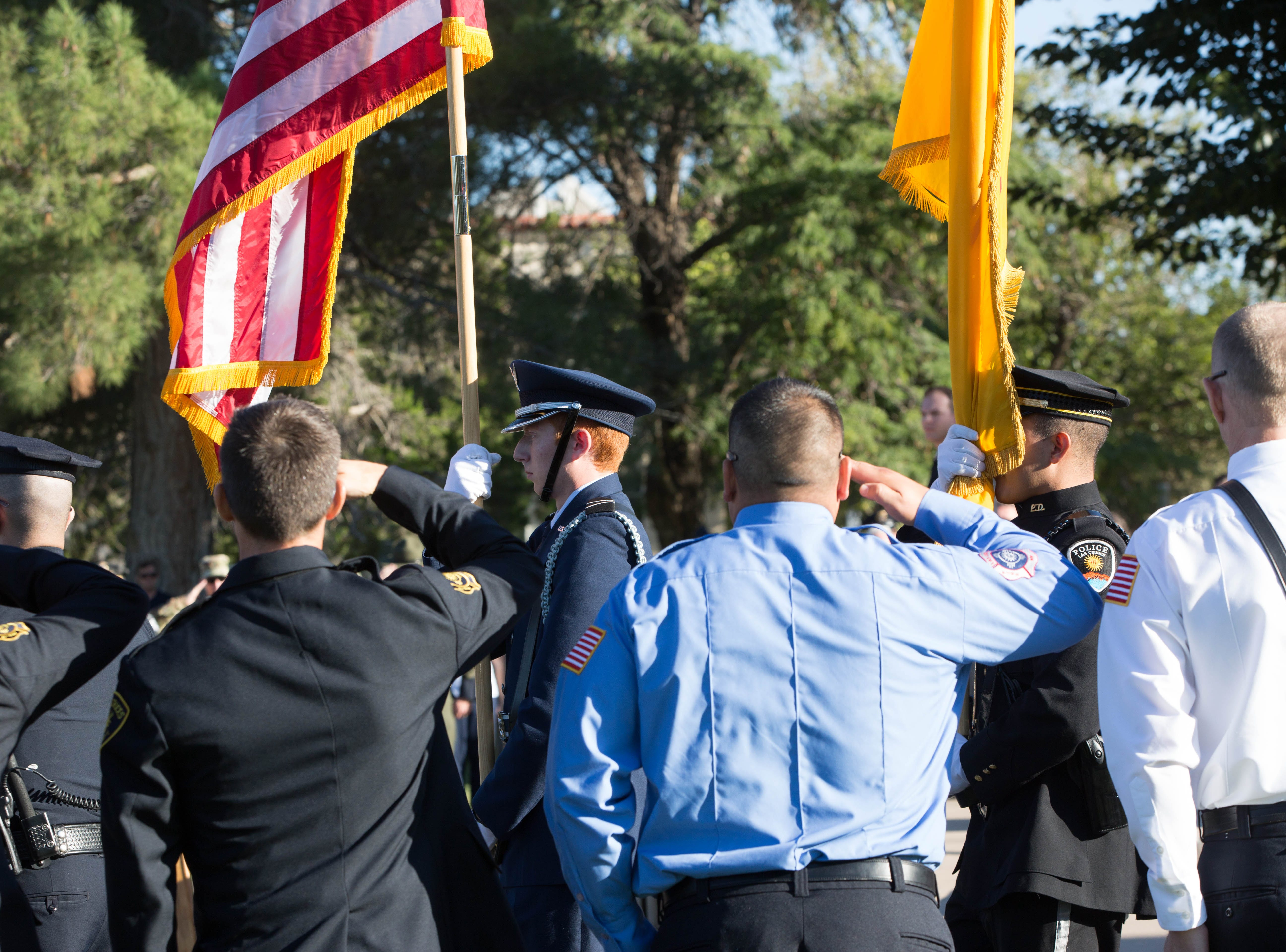 A line of firefighters, police officers and other first responders stand at attention during the opening of the Patriot Day ceremony at New Mexico State University, Tuesday, Sept. 11, 2018. The ceremony was held at New Mexico State University to commemorate the men and women that lost their lives in the 9/11 attacks as well as to thank first responders for their service.