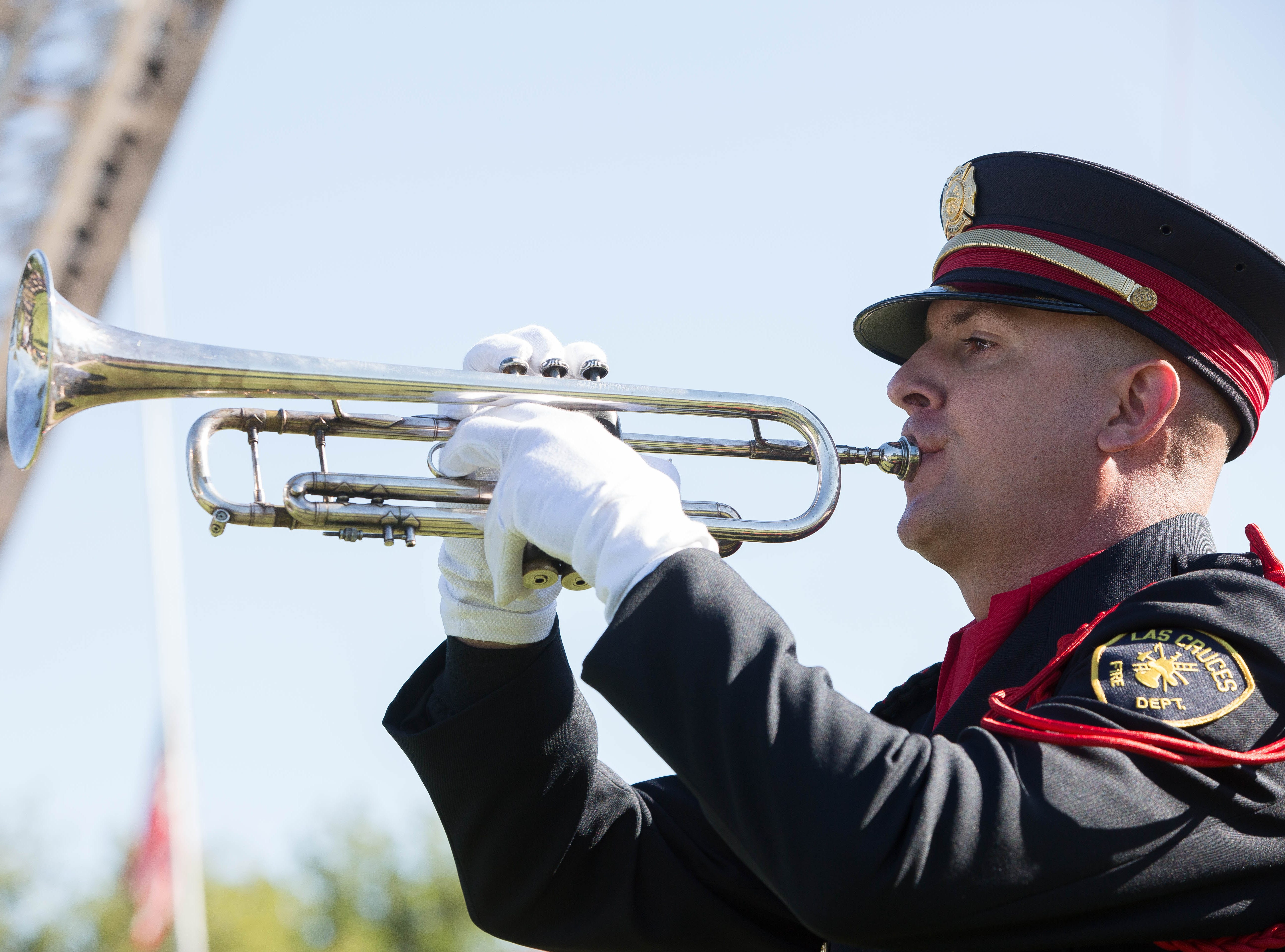 Michael Danner, a fire investigator and member of the Las Cruces Fire Department Honor Guard, performs taps during the Patriot Day ceremony at New Mexico State University Tuesday, Sept. 11, 2018.