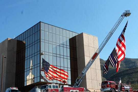 The flags on Alamogordo Truck 1 were raised before the inaugural 9/11 stair climb at the New Mexico Museum of Space History.