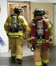 Alamogordo Firefighters enter the stairs as part of the inaugural stair climb relay at the New Mexico Museum of Space History.