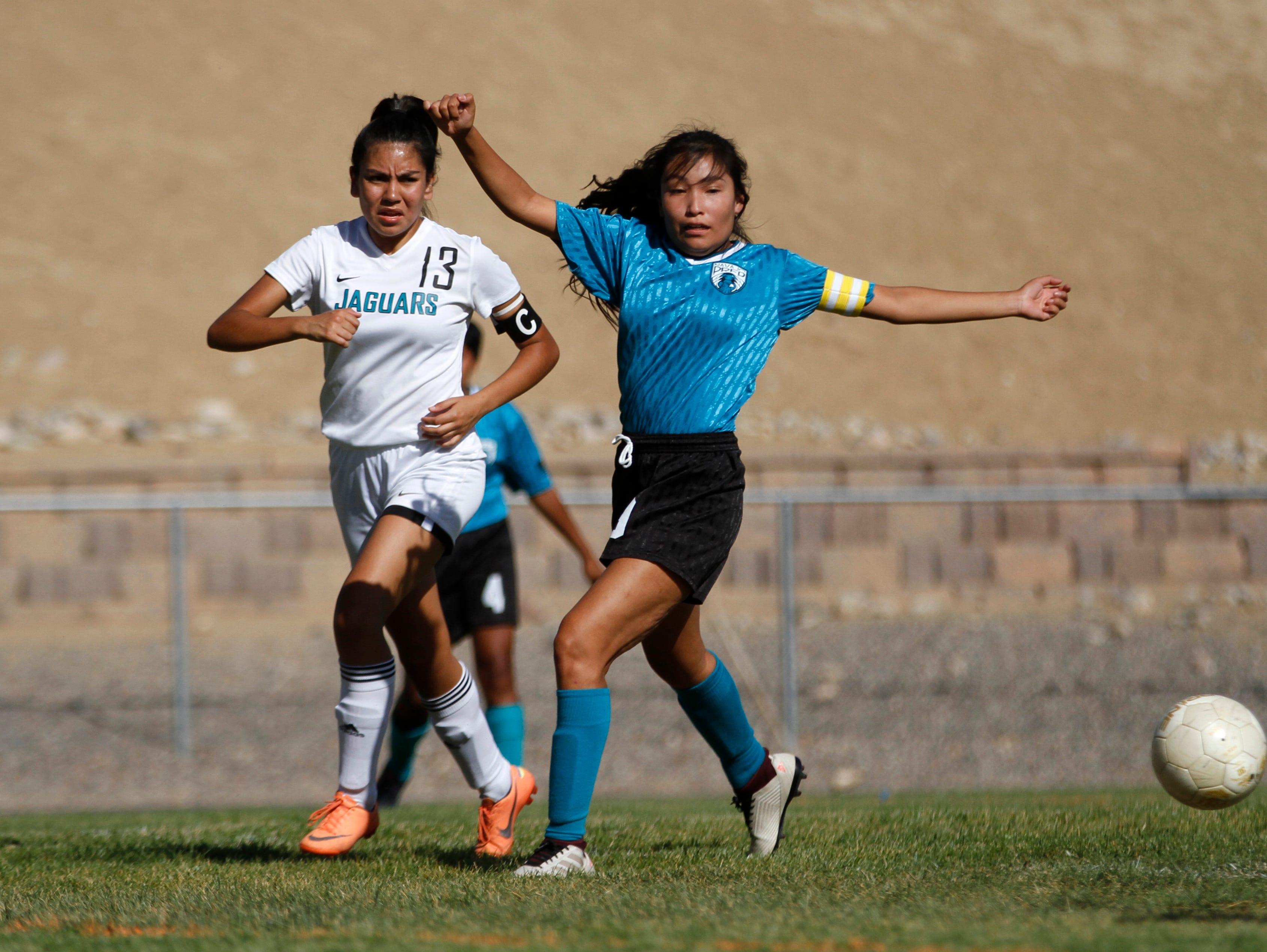 Capital's Melissa Santos  and Navajo Prep's Geena Tsosie  chase the ball, Tuesday, Sept. 11, 2018 at Eagle Stadium in Farmington.