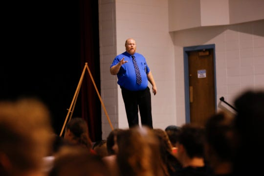 Aztec High School Principal Warman Hall speaks to his students during a presentation on the Say Something Anonymous Reporting System Tuesday at Aztec High School.
