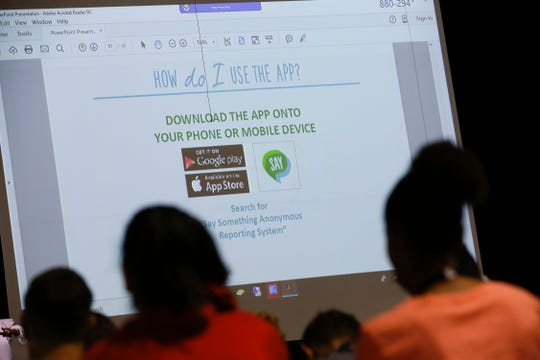 Aztec High School students listen to a presentation on the Say Something Anonymous Reporting System app Tuesday during a school assembly at Aztec High School.