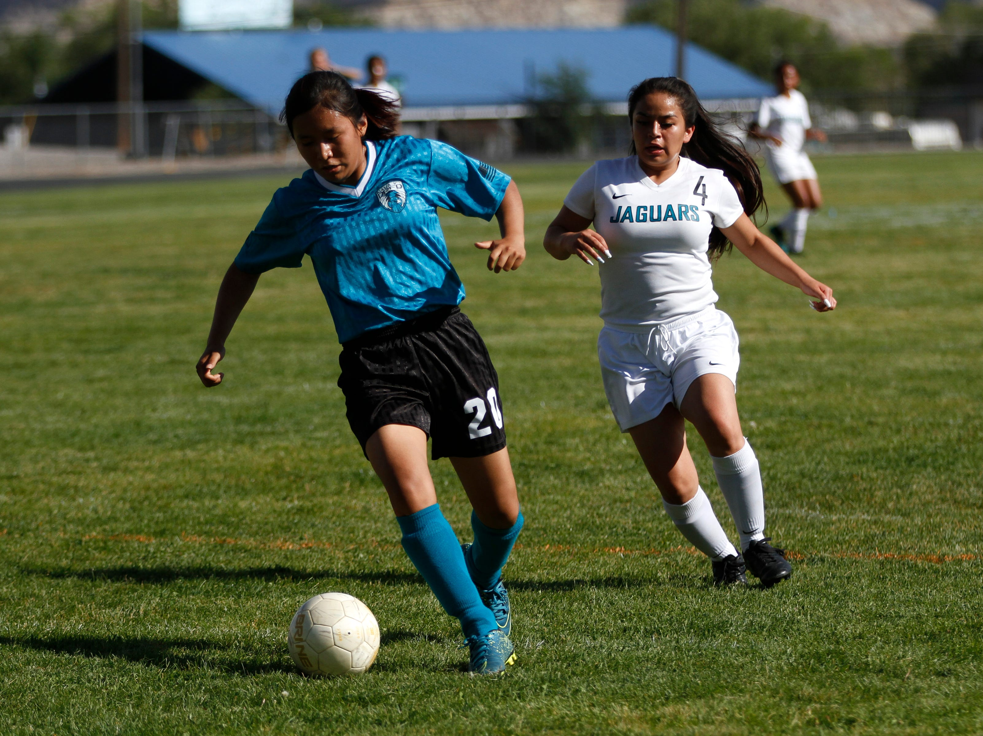 Navajo Prep's Kylie Begay moves the ball up field during their game against Capital, Tuesday, Sept. 11, 2018 at Eagle Stadium in Farmington.