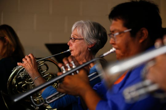 Karon Lyon plays the french horn Tuesday during a Young Audiences concert at Park Avenue Elementary School in Aztec.