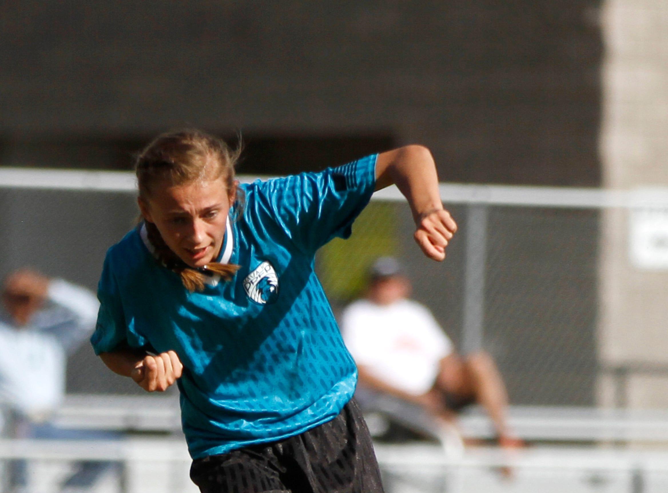 Navajo Prep's Emma Mohs passes the ball to a teammate, Tuesday, Sept. 11, 2018 at Eagle Stadium in Farmington.