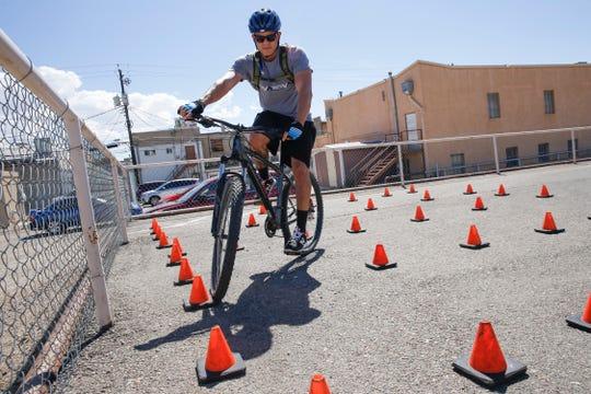 Farmington police Officer Alfonso Sifuentes steers through a bike course Monday during a Law Enforcement Bike Association certification class in downtown Farmington.