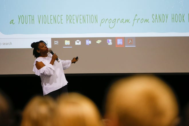 Dalhia Perryman, a senior trainer with Sandy Hook Promise, gives a presentation on the Say Something Anonymous Reporting System Tuesday at Aztec High School.