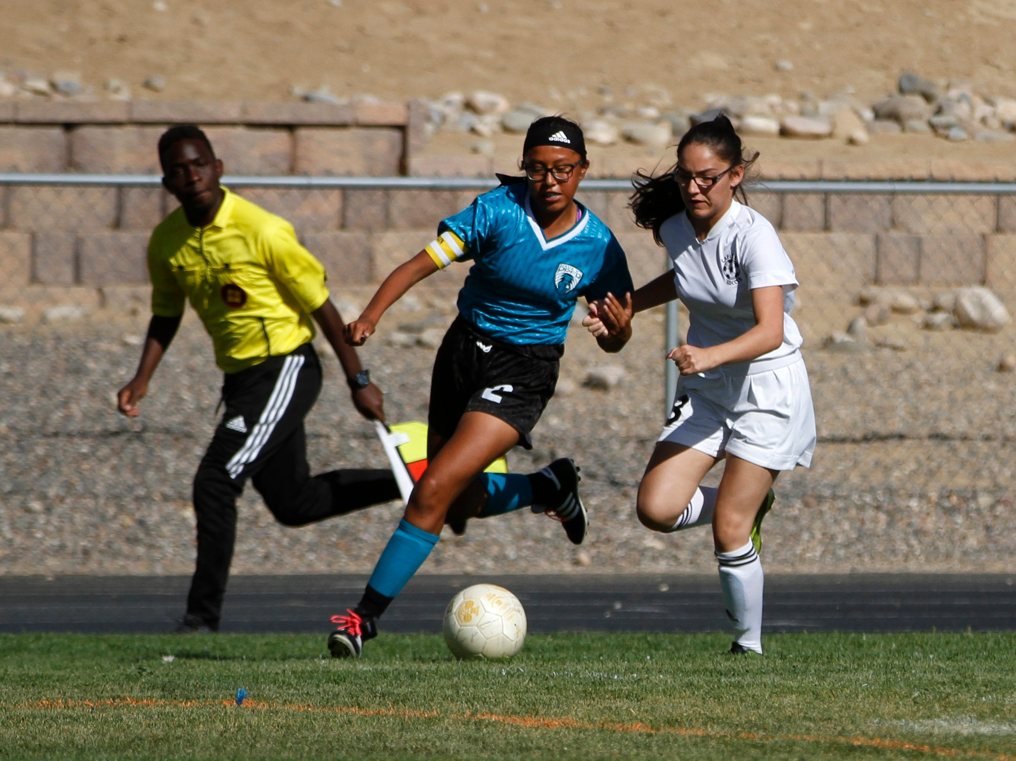 Navajo Prep's Mya Benally tales control of the ball from Capital, Tuesday, Sept. 11, 2018 at Eagle Stadium in Farmington.